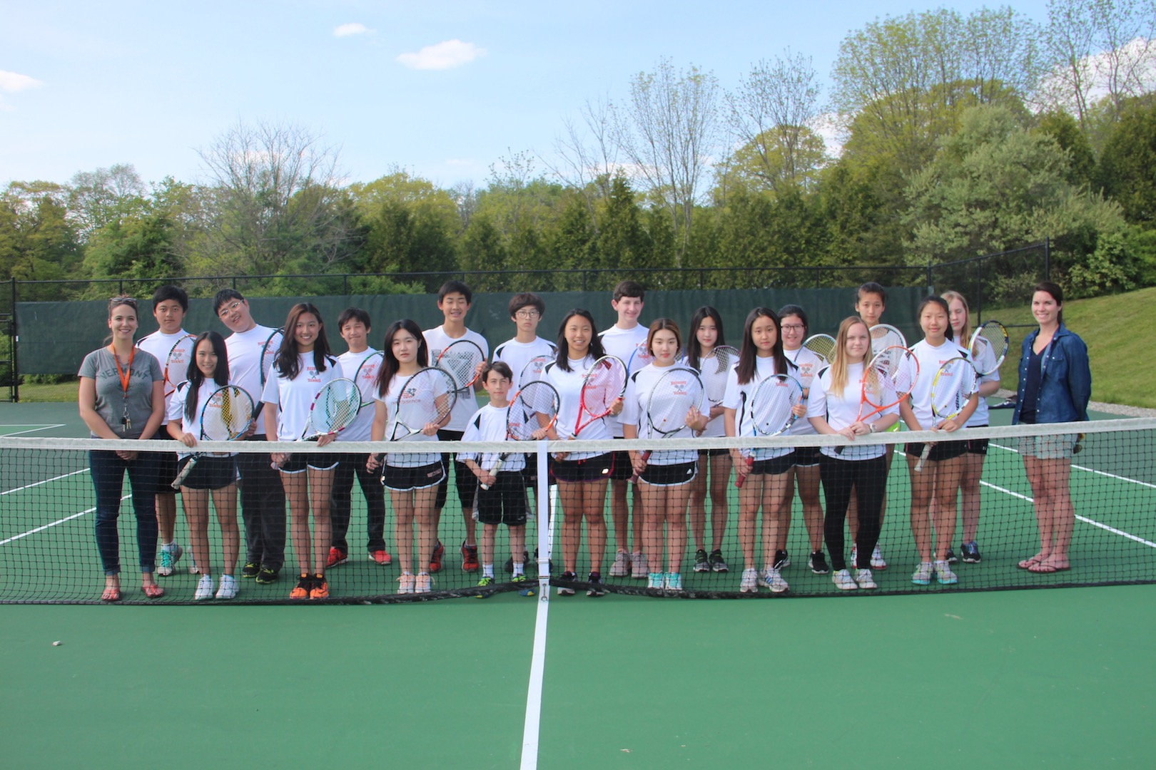 Rectory's 2016 JV Tennis Team with their coaches, Ms. Slocum and Mrs. Burke. The players enjoy working with their coaches and feel they have learned a lot of tennis skills from them.