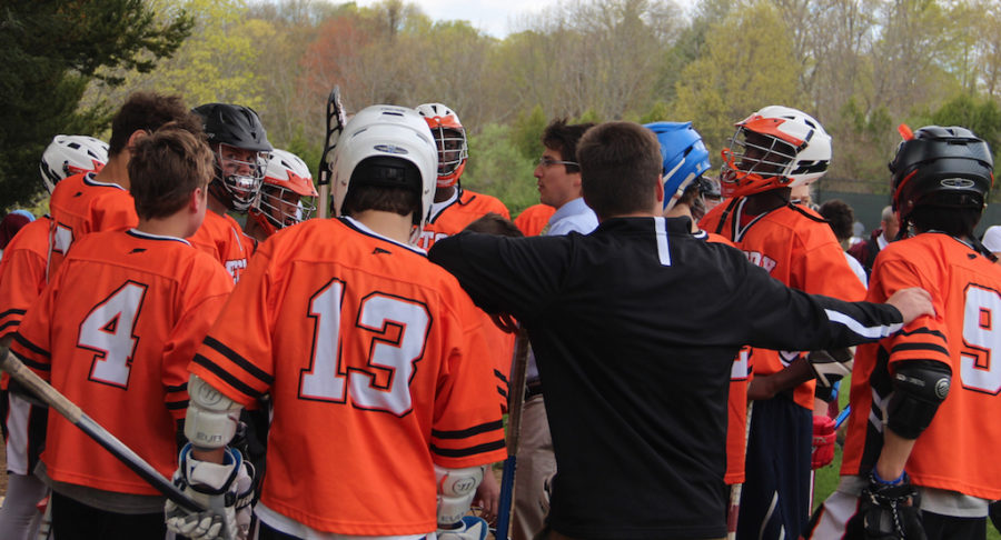 Lacrosse+team+huddle+with+Coach+Gray+and+Coach+Smith.+%22Let%27s+get+the+boys+going%21%22