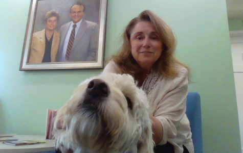 Rectory's new IIP tutor, Ms. Miller, with her therapy dog, Lucy.