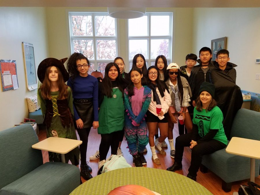 Mrs.+Sangiolo+%28sitting%2C+far+right%29+and+members+of+Rectory%27s+Community+Service+Elective+in+their+Halloween+costumes.