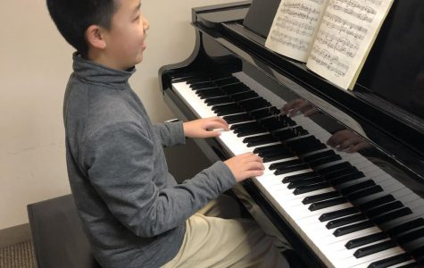 Andy playing the piano. (Photo by Rectory tutor, Jen Hague.)