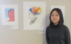 Rectory 9th-grader, Fiona J., next to her award-winning artwork.
