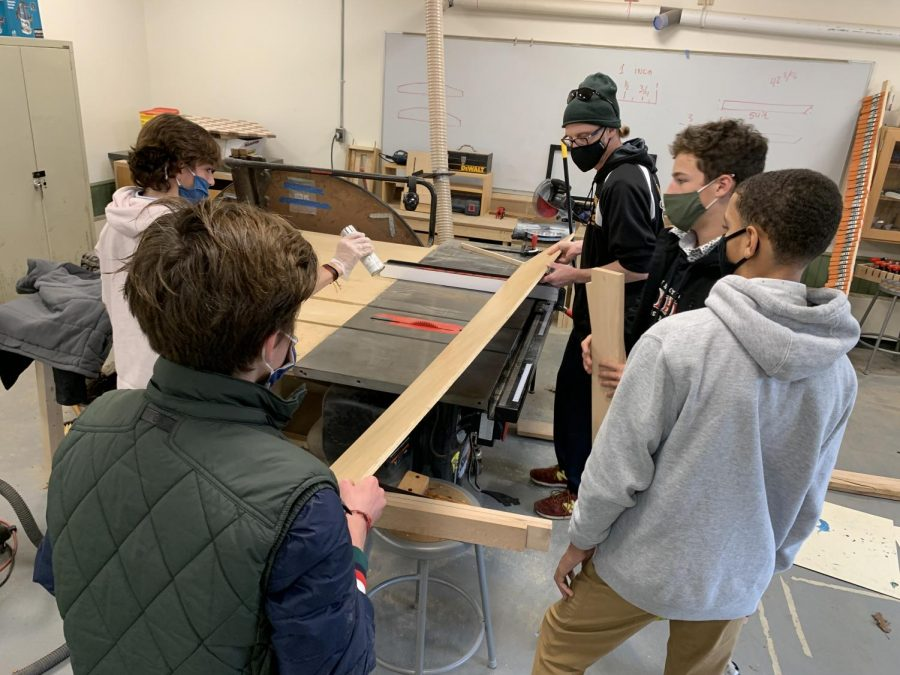 Mr.+Fuller+%28standing+in+back+on+right+side%29+working+with+students+in+his+9th-grade+Woodshop+class.