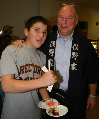 Mr. Gray with his father when he was a 9th-grade student at Rectory in 2009.