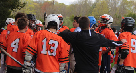 "Lacrosse team huddle with Coach Gray and Coach Smith. ""Let"