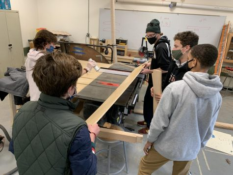 Mr. Fuller (standing in back on right side) working with students in his 9th-grade Woodshop class.